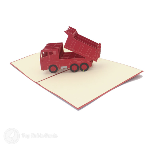 This fun greetings card has a 3D pop up design showing a red dumper truck tipping a load behind it.