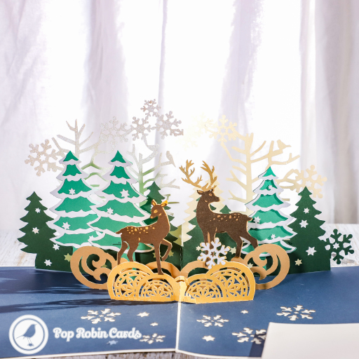 This magical Christmas card has a 3D pop up design showing reindeer in a beautiful snowy forest. The cover has a stylish stencil design showing a reindeer.