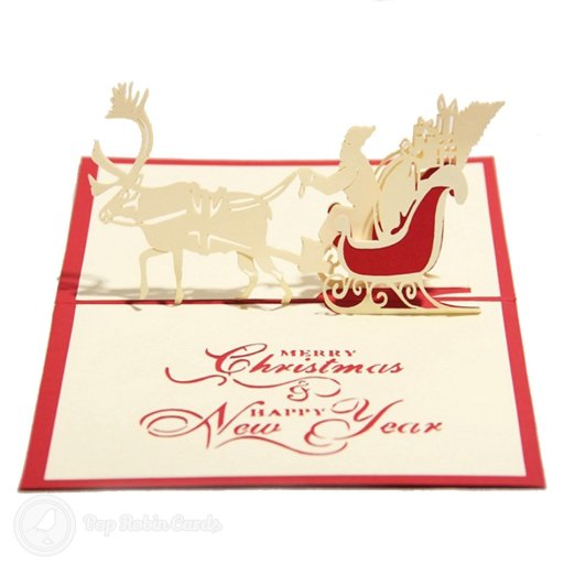"This card has a ""Merry Christmas & Happy New Year"" stencilled message, with a 3D pop-up design showing a reindeer pulling Father Christmas on his sleigh with presents."