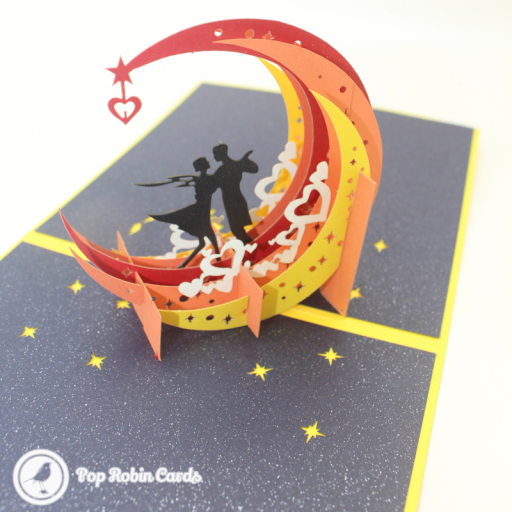 This stunning card opens to reveal a 3D pop up design showing a silhouetted couple design on a colourful crescent moon. The cover has a stencil design showing the moon over water.