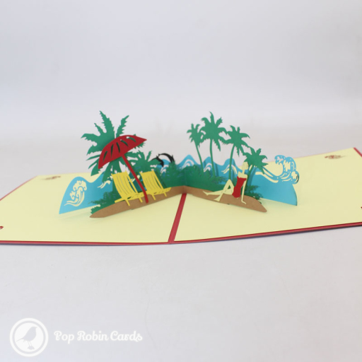 This lovely card captures the relaxation of a sideside holiday on the beach, with rolling waves, palm trees and a parasol. The cover has a stencil design showing a sunset over the sea.