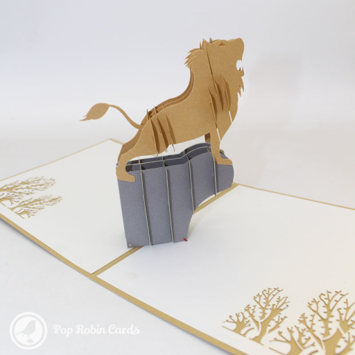 This dramatic card opens to reveal a 3D pop up design showing a lion with a long mane standing on a rock and roaring. The cover has a stencil design showing the lion with his mane.
