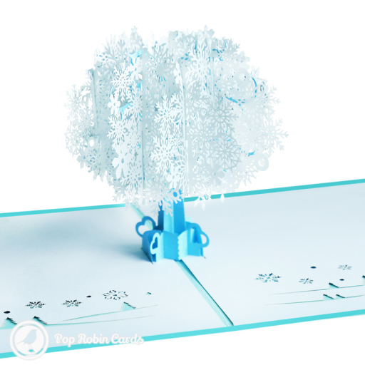 This unusual and stylish card has a 3D pop up design showing a winter tree covered in icy blue snowflakes. The cover has a stencil design also showing the snow-laden tree.