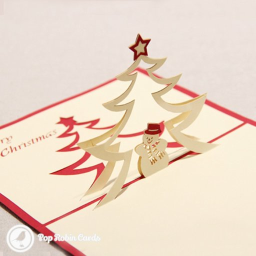 "This charming Christmas card opens to reveal a 3D pop-up design showing a smiling snowman below a Christmas tree topped with a star. A stenciled ""Merry Christmas"" message appears inside, and the cover has a stenciled Christmas tree design."