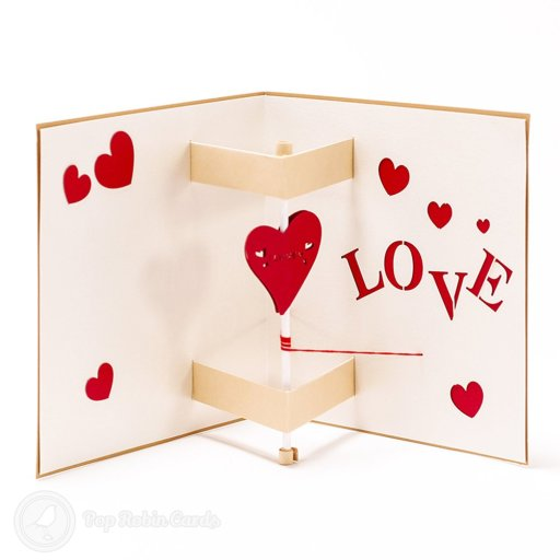 This unique card opens to reveal a moving 3D pop-up design with a love heart that spins as the card is opened. This romantic card is sure to amaze someone special, and is available in subtle beige or bright colourful themes.
