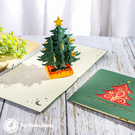 This amazing Christmas card has a wonderful 3D pop up design showing a green Christmas tree decorated with gold baubles and a star. The cover design also shows a warmly decorated Christmas tree.