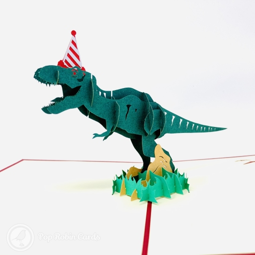 "This hilarious birthday card has a 3D pop up design showing a fearsome t-rex dinosaur wearing a ridiculous party hat. The cover design also shows the t-rex and a ""Happy Birthday"" message."