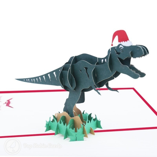 This funny Christmas card is sure to get a laugh from any dinosaur fan, with its 3D pop-up design showing a fearsome T-Rex dinosaur wearing a Christmas party hat. The cover has a stencil design also showing a T-Rex dinosaur.