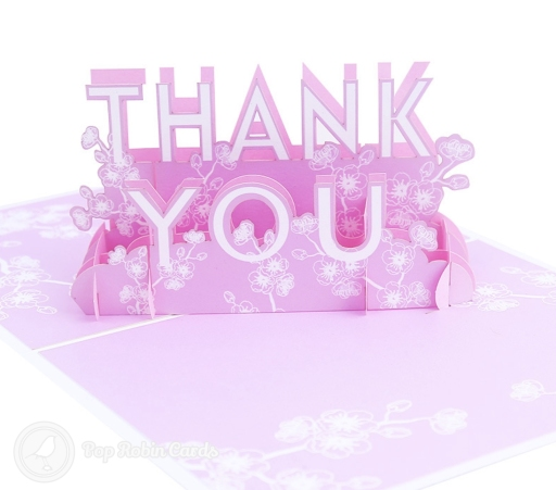 "This card is perfect for expressing your gratitude, with its 3D pop up design showing the message ""Thank You"" in floral pink. The cover has a stencil design also showing the message ""Thank You""."