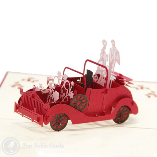 This greetings card shows a newly married couple in a classic red car on their wedding day. It's a perfect card for an engagement, wedding, or for a newlywed couple. The cover also shows the wedding car in a stencil design.
