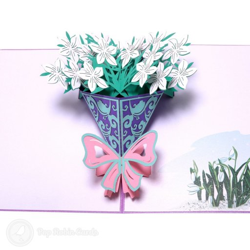 This beautiful 3D pop-up card opens to reveal a bouquet of lovely white gardenia jasmine bursting from a bouquet decorated with a purple ribbon