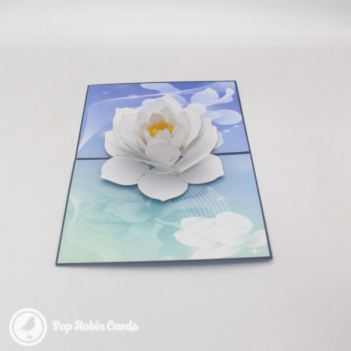 This beautiful greetings card has a 3D pop up design showing a vivid white lotus flower on a pool of pure water. The cover has a stencil design also showing a lotus.