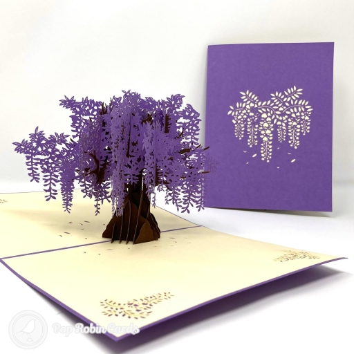 This stunning card is suitable for many occasions with its gorgeous 3D pop up design showing a wide and vibrant Japanese wisteria tree brimming with vivid purple blossom. The cover has a stencil design also showing the wisteria.