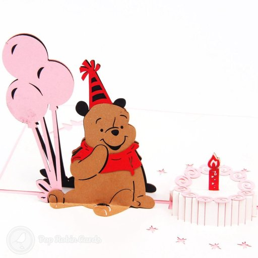 "This birthday card folds flat but opens to reveal a cute 3D pop-up design showing Winne the Pooh with balloons, a party hat and a birthday cake. The cover also shows the classic character along with a ""Happy Birthday"" message."