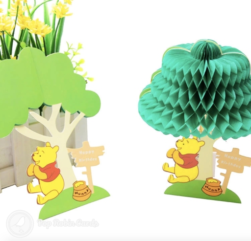 This cute card shows the famous bear eating honey off his paws underneath a tree. The scene folds flat but opens into a 3D pop out design. There is a separate card to write your message on.